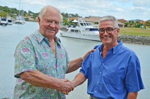 Gold Coast International Marine Expo president Stephen Milne (right) hands the reigns over to Gold Coast boating and business leader Patrick Gay AM